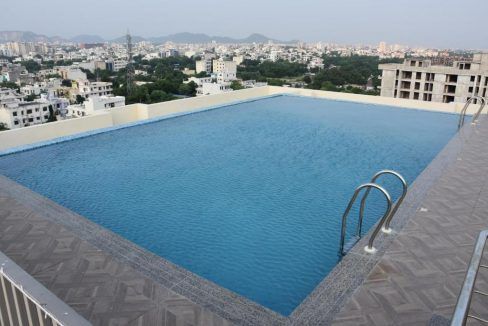 flats for sale near airport jaipur - swimming pool